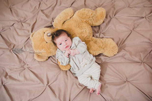 Rebecca pictured with a teddy bear once belonging to daddy when he was very little!