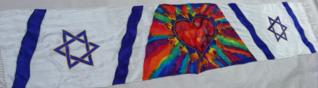 White background, firey heart surrounded by color, blue Stars of David on each end, fringed silk scarf