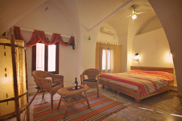 Spacious and cosy. Hotel Review: Fauzi Azar Inn - A 200 year old Arab Mansion in Nazareth, Israel © Sabrina Iovino | JustOneWayTicket.com