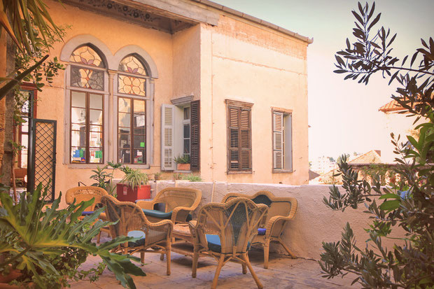 The perfect terrace for a tea and a good book. Hotel Review: Fauzi Azar Inn - A 200 year old Arab Mansion in Nazareth, Israel © Sabrina Iovino | JustOneWayTicket.com