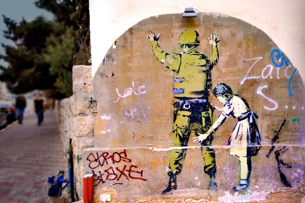 The British graffiti artist Banksy visited the West Bank in 2005 and painted several images along the separation wall and in the town of Bethlehem. © Sabrina Iovino | JustOneWayTicket.com
