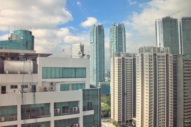 Skyline view from my room at The Linden Suites, Manila, Philippines © Sabrina Iovino   JustOneWayTicket.com