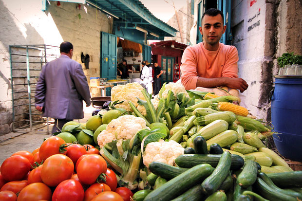 A young man selling veggies in the streets of the Old City of Nablus, Northern West Bank. © Sabrina Iovino | JustOneWayTicket.com