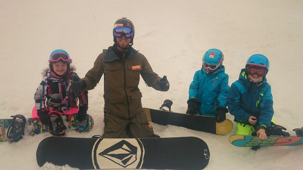 Lily, Ben and Brodie enjoying their lesson, and TORR Snowboarding stickers!
