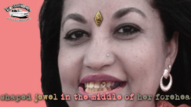 Photo of Mrs. Chopra, an indian lady with a diamond shaped jewel on her forehead and a gold tooth.