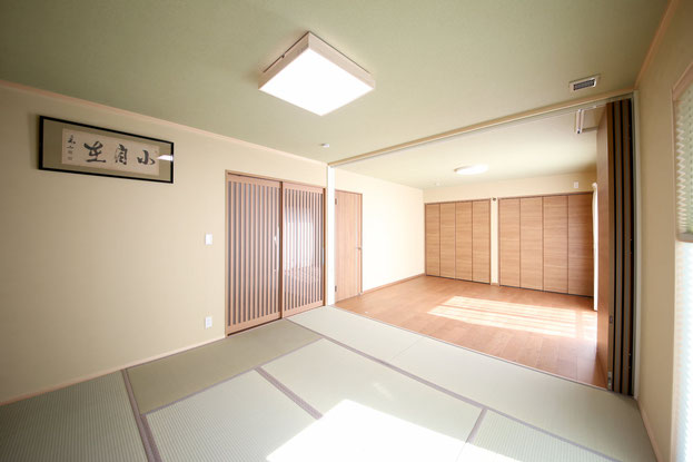 M様邸可動間仕切りで開閉する和室と洋室