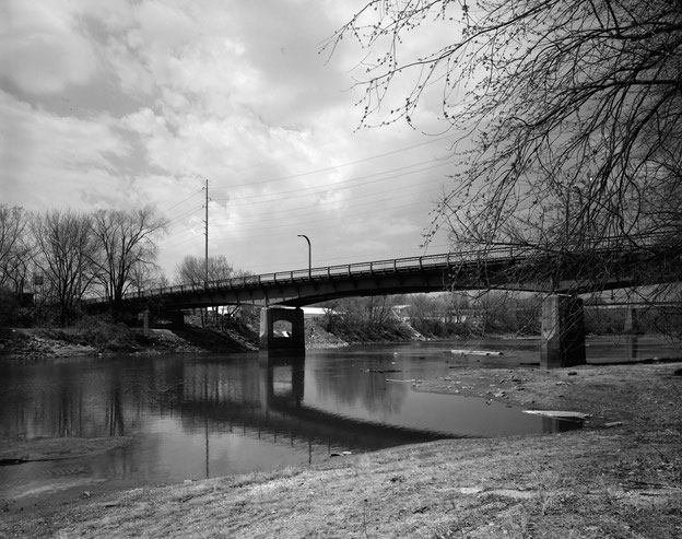 View of the Benton Street Bridge from the west bank of the Iowa River, looking northeast