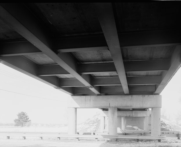 Underside of overpass, showing piers, beams, lateral bracing and deck underside. View to north.