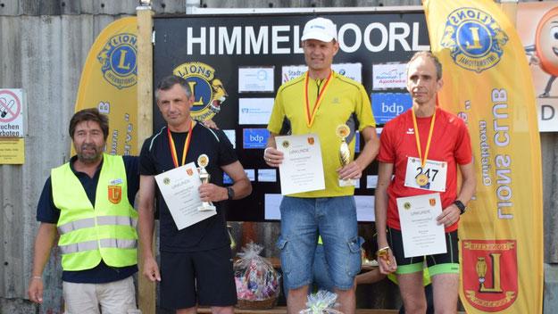 Die Sieger des 4,1-km-Kurzlaufes: Sek Tewes,  Nikolay Nikitin und Martin Kruse