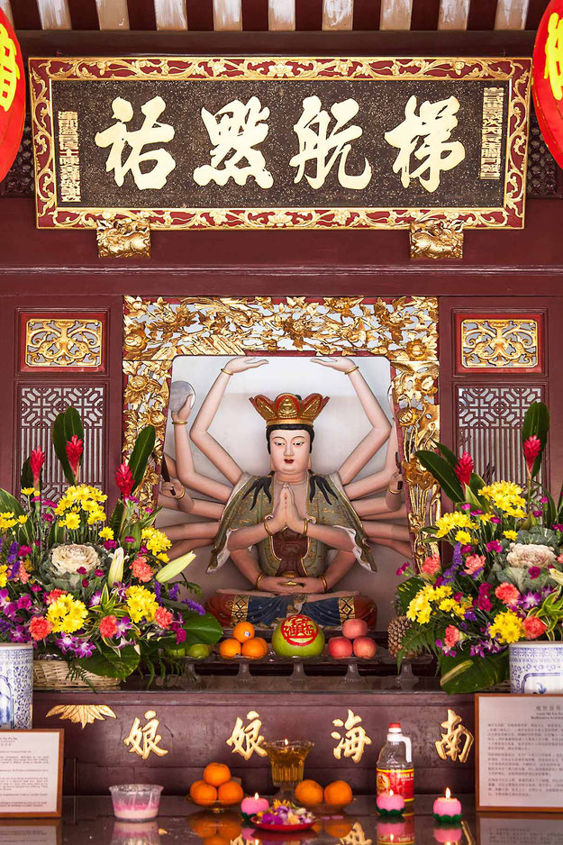Chinese temple statue with many arms and flower decoration, Singapore, 1213x1820px