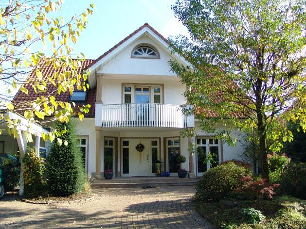 Einfamilienhaus in 49170 Hagen a.T.W. - Architektenhaus mit massiver 2-schaliger mineralischer Putzfassade