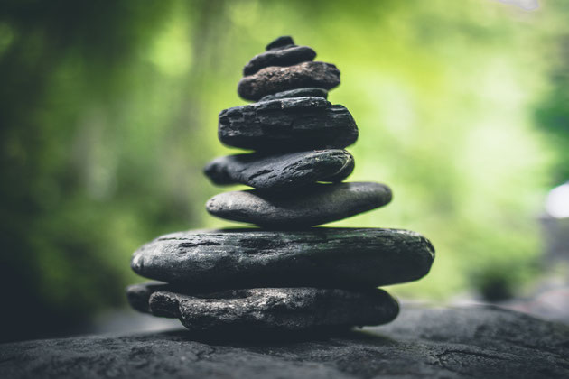 Stones stacked on top of each other in meditative balance