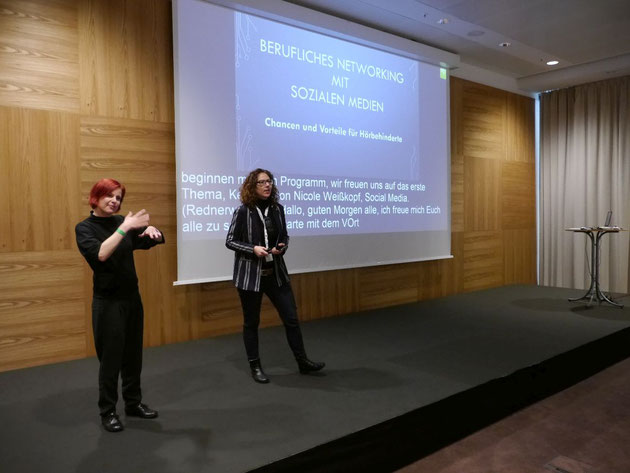 DeafIT conference 2018: Nicole Weißkopf (in the picture on the right)