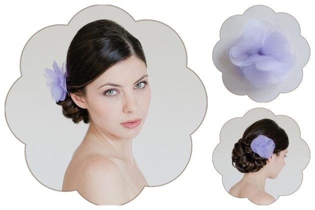 Haarblüte aus Seiden-Organza, veredelt mit einem strahlenden Kristallstein in Lila, flieder, violet.