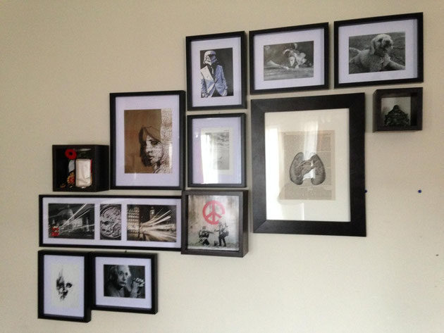 Dollar store frames, black and white art printed off the internet paired with personal momentos created a cool gallery wall for very little expenditure!