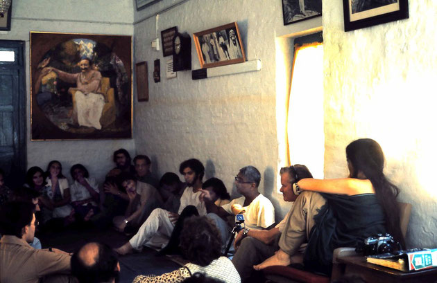 January 1975 - Mandali Hall,Meherazad - John ( wearing headphones ) is next to Eruch recording him & Sher DiMaggio sitting on chair ; photo A.Zois