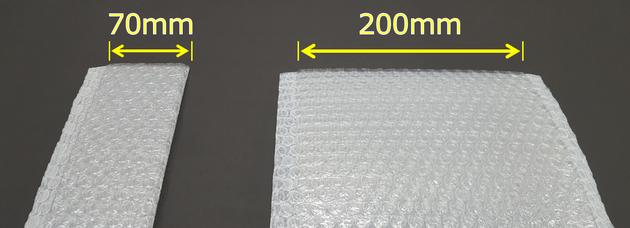 従来品(右)では口幅200mmが最小であったが、今回ご紹介する細口チューブ原反(左)は、最小口幅70mmを実現しました。