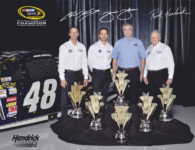 L-R:  Chad Knaus, Jimmie Johnson, Charles Macdonald, Rick Hendrick, and 6 championship trophies