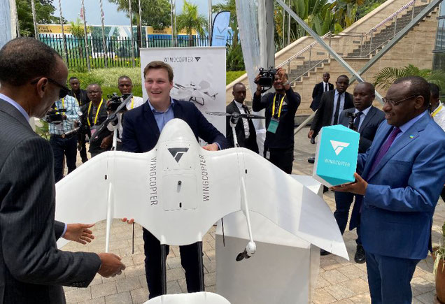 Wingcopter Chief Tom Pluemmer presents one of his drones to President Paul Kagame of Rwanda (standing left) -  images courtesy of Wingcopter