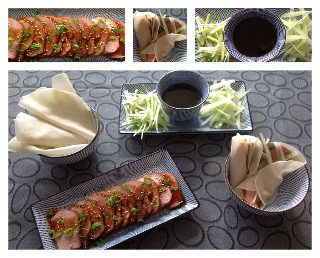 Aziatisch gemarineerde varkenshaas met bosuitjes, komkommer en Pekingeend wraps.