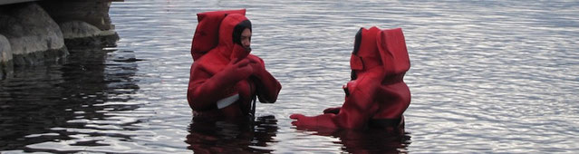Just a usual sunday: Two people talking in their survival suits...