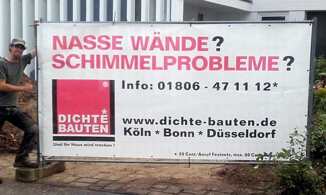 Baustellenschild Abtec mit Mitarbeiter Köln Bonn Düsseldorf