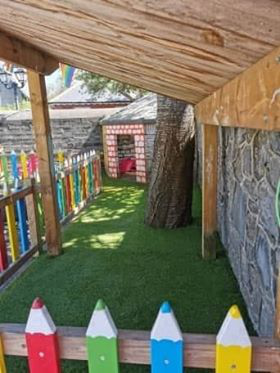 great outdoor play area with planting and push toys