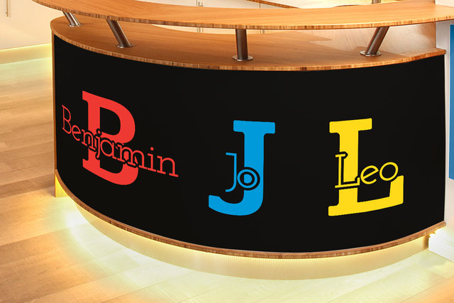 Benjamin, Jo and Leo customisable vinyl decal name on the bottom of a wooden kitchen counter. More colour options are available from www.wallartcompany.co.uk