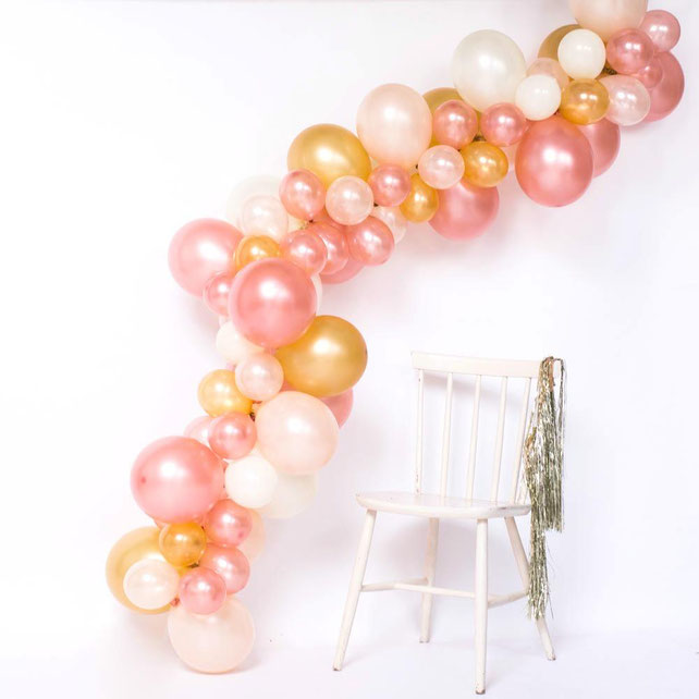 como hacer una tira de globos