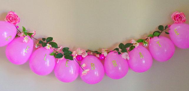 como hacer una cadena de globos