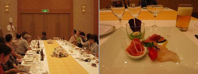 参加者でジビエ料理を味わう写真