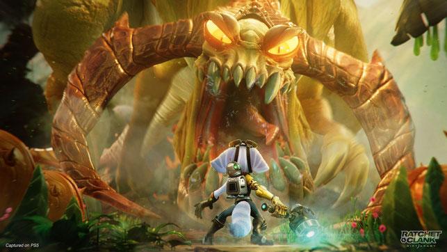 Rivet und Clank stehen vor einem Monster in Ratchet & Clank: Rift Apart von Insomniac Games auf der PlayStation 5