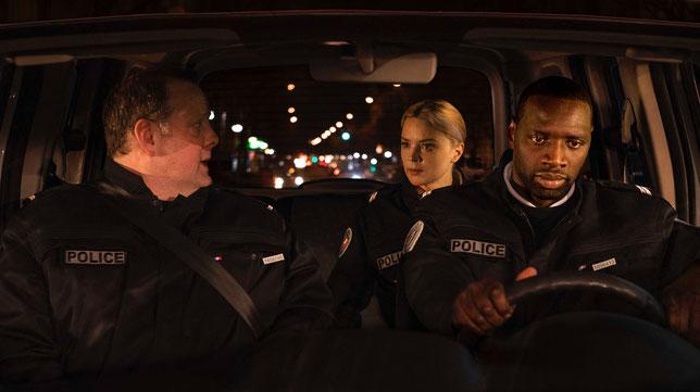 Erik, Virginie, Aristide (Grégory Gadebois, Virginie Efira, Omar Sy, de gauche à droite): trois flics ordinaires placés dans une situation qui ne l'est pas (©StudioCanal).