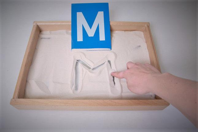 caja de arena montessori