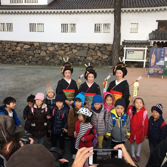 Miss Toka Ebisu and Children crowded around by a number of photo shooters
