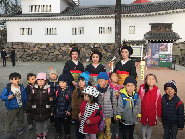 Children with Miss Toka Ebisu in front of Kokura Castle
