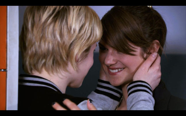Jenny and Emma are making out at the lockers.