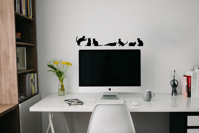 Set of 7 cats wall art stickers. Some pouncing, laying down and sitting.