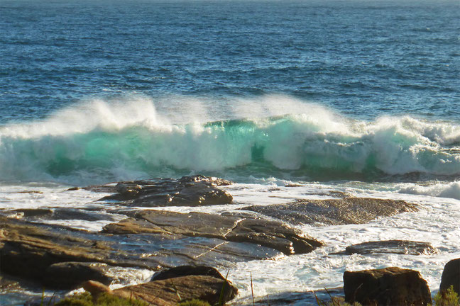 A wave breaking on the headland