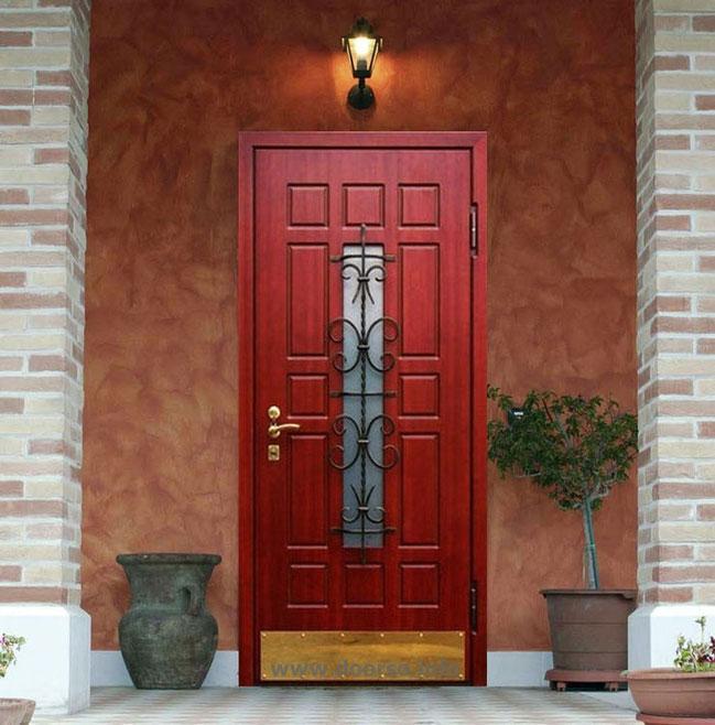 металлические двери с окном + ковка.
