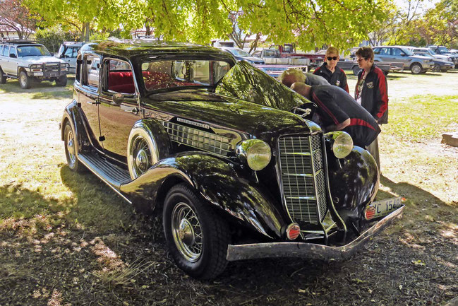 A shiny Auburn supercharged straight-eight