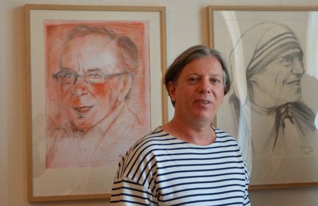 Albanian artist Gazmend Freitag (1968) in front of his paintings at exhibition to Embassy of Albania in Vienna, 2015. Photo: Keti Berisha