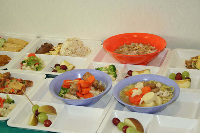 Examples of healthy bento set meals served in childcare centres/ schools.