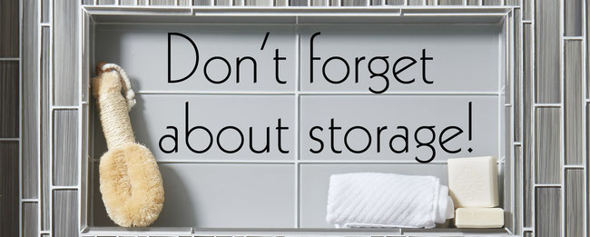 "Recessed shower shelf with a bar of soap and the words, ""Don't forget about storage!"""