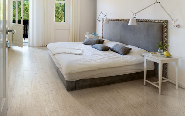 Light oak wood tile floor in a bedroom.
