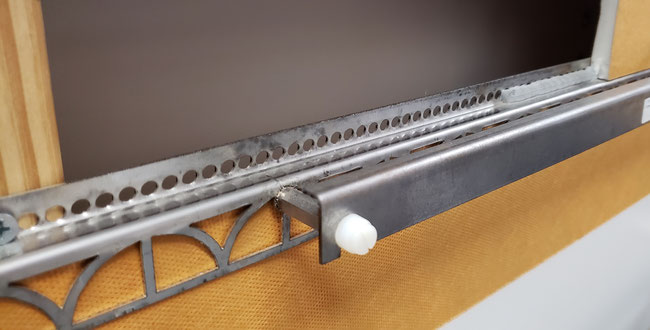 Close up of the grab bar anchoring leg on a piece of Kerdi board, mid-install.