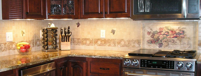 Stone Impressions kitchen backsplash with mural and drops, granite countertop, and dark cherry cabinets