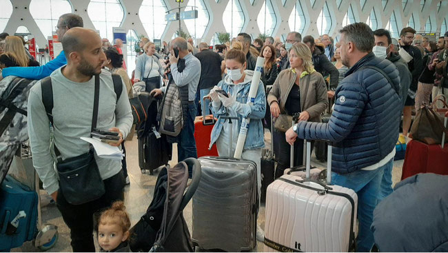 Stranded tourists after Morocco halted flights  -  image courtesy CNN