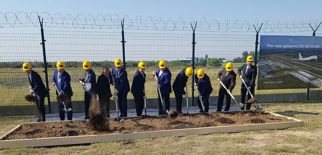 'Men at work' at Budapest Airport, eleven managers turning the sod for a new Cargo Center  -  pictures: hs