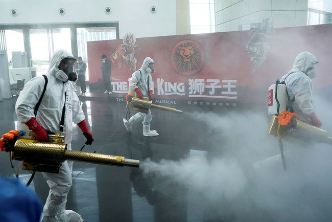 Wuhan Sanitizing Squad at work  -  image courtesy Reuters